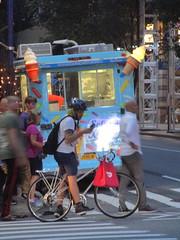 Ice Cream Truck with Cone Plastic Lanterns 6683 (Brechtbug) Tags: giant ice cream cone plastic lanterns front sky blue that looks green light truck sunset evening 8th avenue 50th street nyc 2018 new york city 07302018 dessert trucks bike bicycle man
