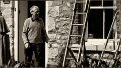 Should you be doing that at your age ? (Neil. Moralee) Tags: beerdevonneilmoraleesigma150500 neilmoralee old mature pensioner ancient age concern work working painter builder beer devon penssion risk danger man sepia black white mono monochrome neil moralee nikon d7200 blackandwhite bw bandw cottage repair stone wall ladder climb window steps
