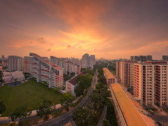 Overlooking Potong Pasir (Scintt) Tags: singapore state structure building architecture skyline city cityscape hdb housing estate sun sky clouds dramatic surreal epic light glow travel urban exploration skyscrapers construction wideangle scintillation scintt jonchiangphotography apartments flats homes landscape clear real residential residences public stitched vantagepoint sunset dusk twilight evening trees orange yellow panorama stitch burn potongpasir haidafilter neutraldensity
