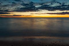 A Michigan Summer's Edge (matthewkaz) Tags: lake lakemichigan water greatlakes christmascove christmascovebeach sunset sky clouds reflection reflections leelanau summer michigan puremichigan northport 2017 longexposure beach sand rocks