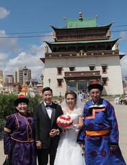 Ulannbaatar Wedding (peterkelly) Tags: digital canon 6d gadventures transmongolianadventure asia mongolia ulaanbaatar gandanmonastery wedding bride groom temple flowers hat traditional dress blue sky family father mother