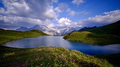 Mountain lake and wild flowers (Funkraft) Tags: bachalpsee berner oberland grindelwald longtime exposure lake schreckhorn alps jungfrau region
