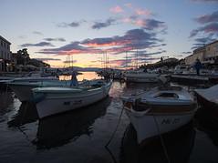 day's end (koaxial) Tags: p6251196a koaxial malinska croatia krk boats harbour sunset sonnenuntergang sky clouds wolken water sea reflection last rays