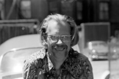040671 02 (ndpa / s. lundeen, archivist) Tags: nick dewolf nickdewolf blackwhite monochrome blackandwhite 35mm film photographbynickdewolf bw may 1971 1970s boston massachusetts people beaconhill mtvernonsquare blurry outoffocus man nd mustache moustache handlebatmustache glasses eyeglasses blond blonde cars vehicles automobiles parkedcars face smile smiling