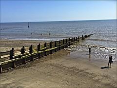 Hornsea (brianarchie65) Tags: hornsea beach sea water shadows railings bluesky eastyorkshire eastyorkshirecoast wood people swimmers unlimitedphotos ngc flickrunofficial flickr flickrcentral flickrinternational ukflickr iphonese brianarchie65 geotagged promenade longwalk
