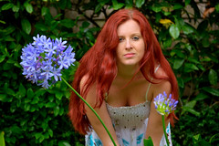 Christiana Flower 1 (TheseusPhoto) Tags: girl female model modeling woman pretty beautiful sexy pose flower color redhair prettyeyes