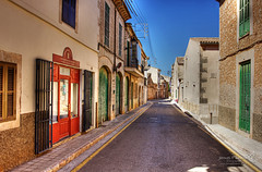 Santanyí 21 June 2018 00027.jpg (JamesPDeans.co.uk) Tags: retail forthemanwhohaseverything landscape doors shutters printsforsale roads windows pavement arch sign commerce street spain majorca jamespdeansphotography vanishingpoint mallorca history architecture wwwjamespdeanscouk landscapeforwalls europe shops digitaldownloadsforlicence