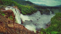 Athirappilly water falls (dan-george) Tags: athirappilly waterfall water spray droplets moutain forest jungle greenary green river sky tree grass landscape
