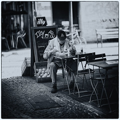 A Quick Bite (Fouquier ॐ) Tags: fruit terrace chairs lunch urban city street cobblestones mono monochrome blackandwhite bw antwerp belgium streetphotography belgian illy bench bicicyle