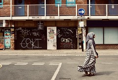 Daily life in Brick Lane - London (Sandrine Vivès-Rotger photography) Tags: london uk bricklane streetphotography street muslim shops eastlondon londres architecture dailylife graffiti streetart woman oneway signs windows