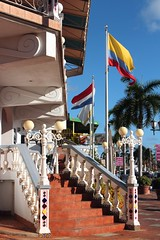 Oranjestad - Aruba (Prayitno / Thank you for (12 millions +) view) Tags: konomark intricate ornaments decoration stairs staircase flag bandera bendera day time outdoor sightseeing tourist spot sunny blue sky oranjestad aruba shopping arcade district downtown down town caribbean