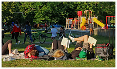 Four Readers in the Park (HereInVancouver) Tags: people outdoors city urban park grass playground books reading readers prone ontheirbacks stanleypark vancouver bc canada candid canong9x ngc