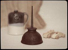 Still Life (N.the.Kudzu) Tags: tabletop stilllife oilcan pottery jug wooden toys cheese cloth canondslr manualfocus primelens zenitar50mmf12 flash dxoopticspro11