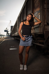 freight train (Michael Kremsler) Tags: model girl blackhair curls denim skirt sneakers portrait fashion streetfashion freighttrain habor summer bokeh evening strobist shooting crane graffiti