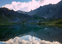 Dawn Reflections (Safarii) Tags: alps france ecrins ecrinsnationalpark nationpark nature europe summer camping wildcamping lake lacs water still calm reflection morning dawn landscape beauty content contentment mountain mountains mountaineering big rock rocky uplands