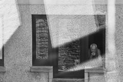 Edinburgh (A-cat-and-a-half) Tags: edinburgh 2018 karinater streetphotography blackandwhite smoking man candid eyecontact reflection geometry light windows textures