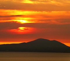 Sunset in snowdonia (lesleydugmore) Tags: sunset dusk uk wales britain europe colours gold golden orange sky sea mountain northwales clouds red