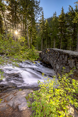 Paradise River (optimalfocusphotography) Tags: sunburst mountrainier summer landscape bridge river nature water sky nationalpark trees sun usa washington