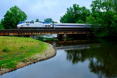 Amtrak Crossing the Kalamazoo River (dangaken) Tags: amtk amtrak wolverine bluewater train rail travel kzoo mi michigan traintravel puremichigan kalamazoo kalamazoomi travelbytrain fuji fujixt2 photobydangaken dgaken 2018 summer nsmichiganline goose geese river water bridge trainonbridge kalamazooriver amtk34