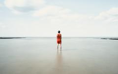 The Woman in Red (The Black Fury) Tags: red blue longexposure minimalist sea seascape water white beach light poselongue sky coast