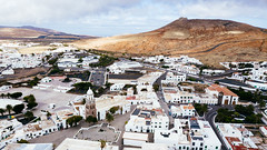 Aerial photo of Spanish town of Teguise on the Canary Islands (marcoverch) Tags: castle landscape beautiful travel trip architecture mountains buildings spain sant eu town city teguise canarias spanien es aerialphoto spanish canaryislands noperson keineperson reise diearchitektur outdoors drausen stadt dorf house haus landschaft sky himmel water wasser building gebäude sight sicht tourism tourismus vacation ferien nature natur cityscape stadtbild scenic szenisch seashore strand summer sommer hill hügel coth5 tamron noiretblanc contrast beer holiday grey nikkor festival