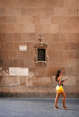 Follower (of fashion) (Dave_Davies) Tags: spain españa andalucia murcia city candid street calle apostles follower woman yellow cathedral architecture
