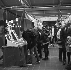 Can I take a closer look? Greenwich Market, London. Film 90(1) (richardhunter3) Tags: greenwich london street yashica 635 tlr ilford delta 400 film analogue bw black white people market