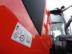 Caution! (stevenbrandist) Tags: tractor kubota orange sticker sign warning caution silly thegamefair vehicle