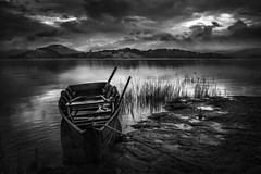 The Boat .. (tchakladerphotography) Tags: landscape beautiful sunset water boat lake light view outdoor tourism nature travel horizon sky environment scenery meghalaya summer scenic clouds grass blackwhite bw landmark hills