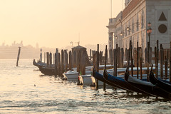 Gondola in the Morning (theseBoetz) Tags: building monuments water italy venice gondola clouds unesco blue boats morning puntadelladogana canal lagoon dawn sunrise architecture gondolas boat medieval sky italia