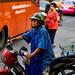Woman riding a motorcycle in Bangkok's Chinatown