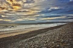 Pebbles (Nige H (Thanks for 15m views)) Tags: nature landscape seascape sunset sky clouds beach pebbles pebblebeach westwardho devon england stormy stormyweather sea ocean waves surf coast coastline southwestengland southwest