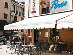 Hot afternoon in Grado (ScotchBroom) Tags: grado italy italia friuliveneziagiulia fvg man oldman afternoon summer wine bar awning