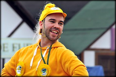 Colourful character (* RICHARD M (7.5 MILLION VIEWS)) Tags: portraits portraiture candid candidportraits candidportraiture streetportraits streetportraiture street yellow fancydress beards bearded rosettes pierhead liverpool merseyside characters expressions liverpudlians scousers scouse merseysiders fun