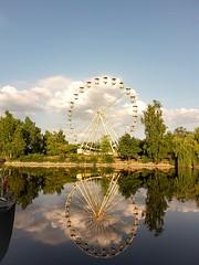 The quiet after the storm (Christian Möller) Tags: serengetipark hodenhagen riesenrad deutschland germany see spiegelung reflection wolken clouds lake themepark freizeitpark