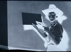 I Can Only Guess (Katrina Wright) Tags: dsc7390 arbutuswalkway cowboy cowgirl negative bw monochrome billboard poster sign signpost guns