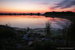 Shoreline Serenity (mallanf61) Tags: sunset sky shoreline clouds cloudsstormssunsetssunrises water reflection