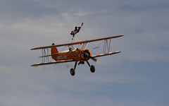 The Flying Circus Wingwalking Team, Shuttleworth Collection Family Air Show, Bedfordshire (IFM Photographic) Tags: img4015a breitlingstearman breitling stearman theflyingcircuswingwalker wingwalker wingwalking nikita aerosuperbatics canon 600d sigma70200mmf28exdgoshsm sigma70200mm sigma 70200mm f28 ex dg os hsm apo tele converter 2x af teleconverter oldwarden bedfordshire beds shuttleworthcollection shuttleworthhouse familyairshow airshow aircraft aeroplane plane airplane boeing