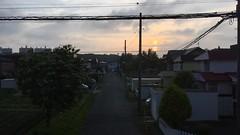 Fast, Fading Sunset (sjrankin) Tags: 20july2018 edited sunset kitahiroshima hokkaido japan road clouds street houses people cars trees video timelapse 1712mb large