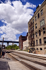 Urban arterial bypass (jkotrub) Tags: urban road street train tracks alley sky clouds bright summer sun sunshine light day daylight renewal decay urbex 52in2018 travel explore architecture building contruction repair lines alone rebuild rust aug2018meeting