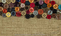 Button isolated on fabric (www.readyelements.com) Tags: arrangement assorted bright button buttonssewing canvas casual circle cloth clothes clothing collection color colorful colour colourful copyspace cotton craft cutout decoration design dress dressmaking fabric fashion fiber group handicraft handmade industry material measure mixed nobody object objects pattern plastic repair round seam seamstress set sew sewing sewingbuttons sewingpattern sewingtools stitch tailor tailoring tape textile texture textured thread tools variety various