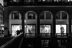 shootin' in the dark (Özgür Gürgey) Tags: 2018 35mm alsterarkaden bw d750 dxonfx hamburg nikon arc architecture evening grainy leading lines lowlight people photographer shopwindow silhouette street