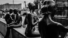 Three Girls And A Boy (AAcerbo) Tags: threegirlsandaboy berlin germany bronze statues riverbank city urban art sculpture statue bw highcontrast