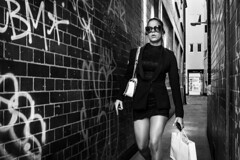 Soho Girl (markfly1) Tags: woman walking girl narrow alley soho london leading lines graffiti bricks hatching black white mono monochromatic legs skirt bag shoes handbag glamorous beautiful candid street image nikon d750 35mm manual focus lens