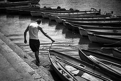 Boatman, Richmond, London (f/me) Tags: boats boat boatman man young worker working river thames london richmond pier bw fuji fujinon blackandwhite water street streephotography canoe