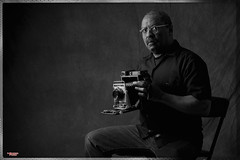 The Photographer (MBates Foto) Tags: blackandwhite camera crowngraphic indoors male man monochrome nikkorlens nikon nikond810 nikonfx people photographer portrait studio spokane wasshington unitedstates 99203