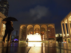 Lincoln Center (Steven Bornholtz) Tags: us usa united states america outdoors summer concert new york city ny nyc manhattan lincoln center steven steve bornholtz djmidway midway dj picture imagery photography getolympus olympus ep5 pen night nightshot clouds fountain rain reflection umbrella people building landmark architecture