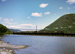 A Penn Central GP38 leads two GP40 and a GP30 south bound over Iona Trestle in Bear Mountain NY, summer 1976 (swissuki) Tags: bearmountain cr gp30 gp38 gp40 ionatrestle ny pc riverline us westshore