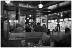 Matzo Ball Soup  (Film) (Harald Philipp) Tags: city street people holiday vacation tourism tourist destination travel blackandwhite bw monochrome schwarzweiss grauzone nocolor dark shadows contrast ilford fp4 35mm film analog analogue filmphotography primelens kodakretina retinaiiic classiccamera rangefinder antiquecamera foldingcamera unitedstates northamerica usa concretejungle manhattan newyork bigapple restaurant diner eating food drink matzoballsoup artdeco candidshot candid indoor blackwhite