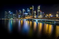 Singapore by Night (volker.meier) Tags: skyline urban city lights night singapore